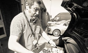 Jimmy loads a car at the The Big Help Project food bank in Knowsley