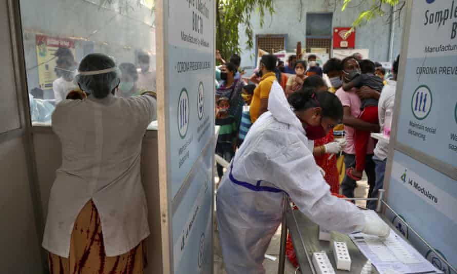 People queue to get tested for Covid-19 in Hyderabad, India,
