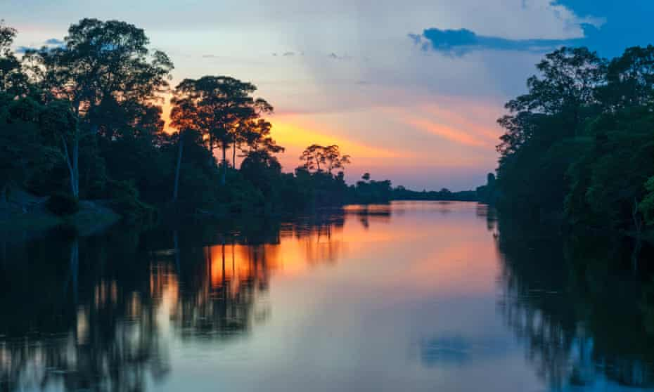 Sunset along the banks of the Amazon river, Peru