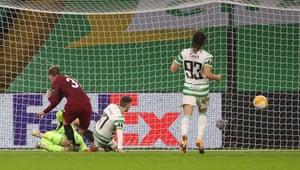 Sparta Prague's Czech forward Lukas Julis (2nd L) shoots to score their third goal past Celtic's Scottish goalkeeper Scott Bain.