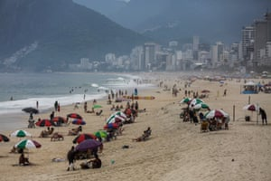 People visit Ipanema beach, a place that normally would be full of people during the carnival season, in Rio de Janeiro, Brazil, 13 February 2021. The city of Rio also cancelled all carnival parties and parades of samba schools.