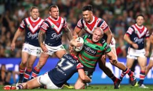 Tom Burgess of the Rabbitohs is tackled by Rabbitohs players at Allianz Stadium in Sydney.