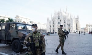 Italian soldiers wearing masks in Duomo Square in Milan.