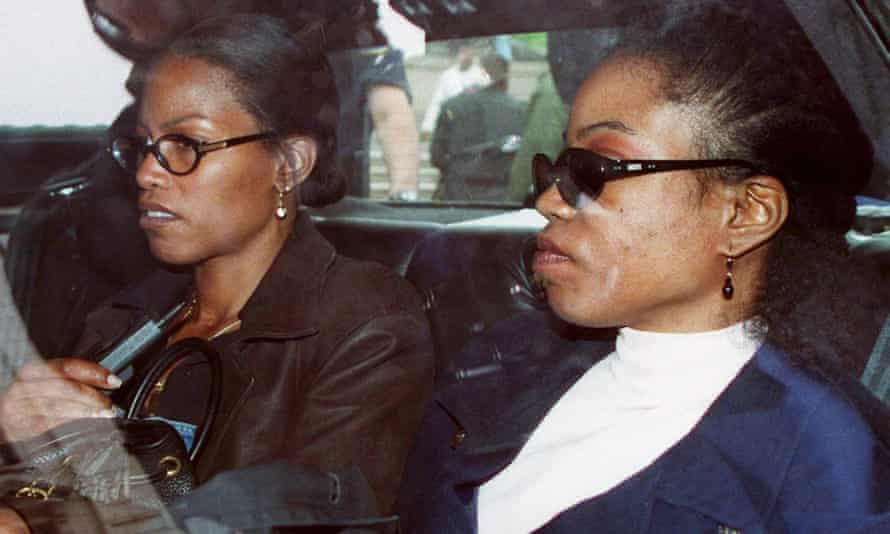 Ilyasah Shabazz, left, and her sister Qubilah Shabazz wait in a car outside family court in Yonkers after attending a court hearing for Qubilah's son Malcolm, 12, who was arrested in June 1997 in connection with the fire at his grandmother Betty Shabazz's home.