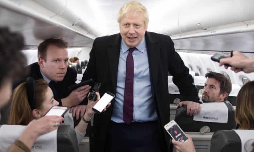 Boris Johnson speaks to the press on his campaign plane