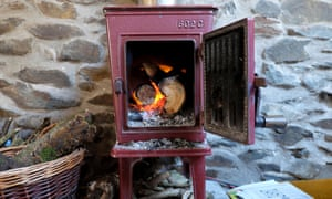 A woodburning stove with door open