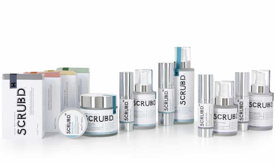 A row of Scrubd products in white and silver packaging
