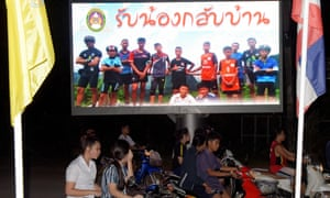 A billboard in Chiang Rai displaying a photograph of the Wild Boars players and their coach with a message reading 'welcome home brothers'.