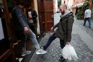 People salute using their feet to avoid contact in Trastevere area, Rome