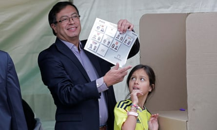 Colombian presidential candidate Gustavo Petro, accompanied by his daughter Antonella, votes in Bogota.