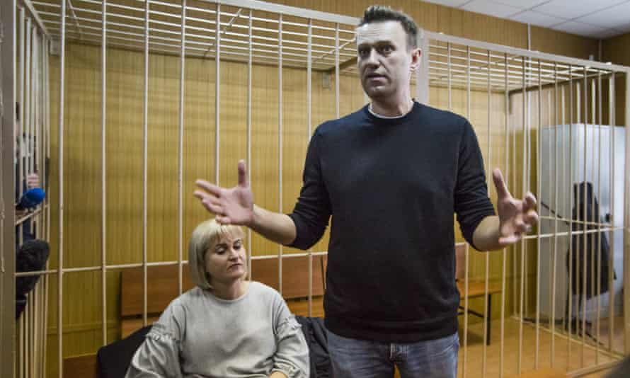 Russian opposition leader Alexei Navalny and his lawyer Olga Mikhailova in court in Moscow on Monday.