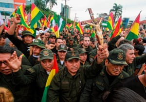 Police officers join in celebrations following the resignation of the Bolivian president Evo Morales in Santa Cruz, Bolivia