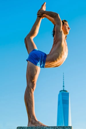 Yoga teacher Jared McCann with the World Trade Center in the background, New York