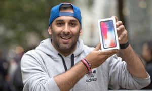 Anup Bansal, 30, who queued outside the Apple Store in Birmingham, holds his pre-ordered iPhone X.