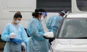 A drive-through coronavirus disease testing clinic in the Warriewood suburb of Sydney, Australia. Authorities are struggling to contain a cluster in the city