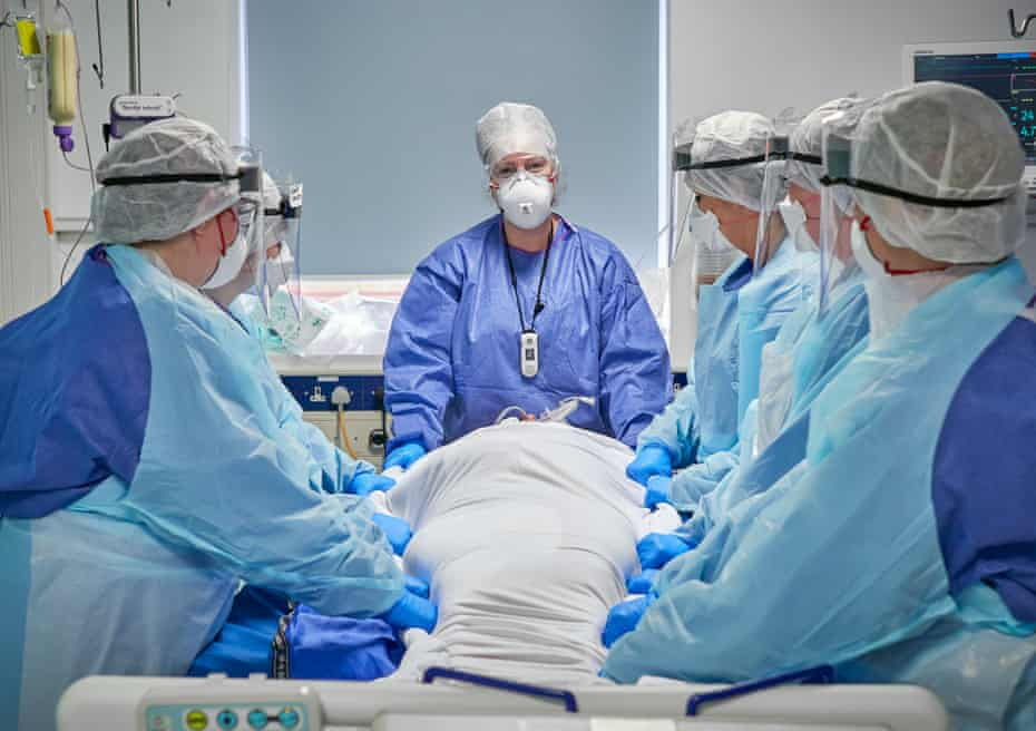 A proning team prepares to prone a patient with severe respiratory failure.