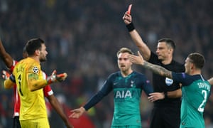 Hugo Lloris is shown a red card by the referee Slavko Vincic during Tottenham Hotspur's 2-2 draw with PSV Eindhoven in their Champions League Group B match.