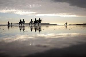 Horse-riders on the beach at Portmarnock, County Dublin.
