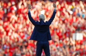 Arsene Wenger waves goodbye to the crowd following his final home match as Arsenal manager after the Arsenal v Burnley Premier League match at the Emirates Stadium in May 2018