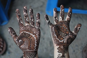 Mehandi (henna) decorations on the hands of a girl at a local market