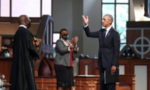 Barack Obama gestures after speaking during the funeral of the late congressman John Lewis in Atlanta, Georgia, on 30 July.