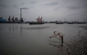Shanghai, China A man casts his net in the Huangpu river