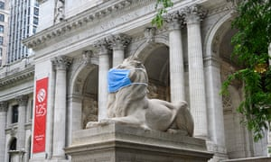 The Patience & Fortitude Lion statue outside The New York Public Library wears a face mask.