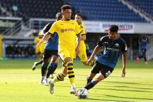 Dortmund's English midfielder Jadon Sancho vies with Paderborn's Tunisian defender Mohamed Drager.