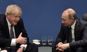 Boris Johnson and Russia's president Vladimir Putin talk during a meeting on the sidelines of an international summit on Libya.