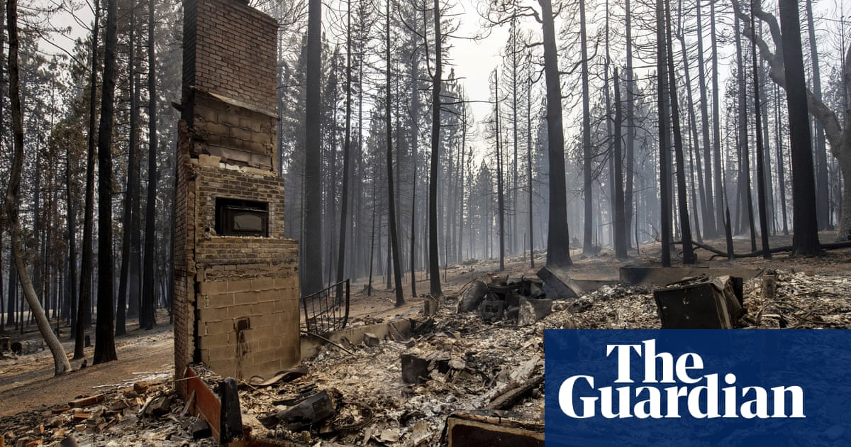 Surging wildfire tears through northern California town and threatens others
