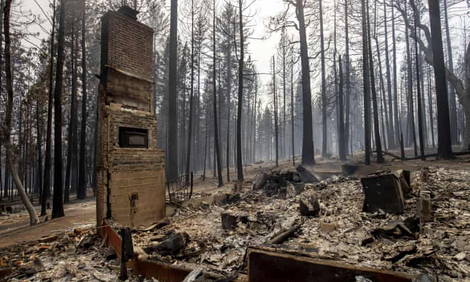 A chimney is left standing after a property was destroyed by the Caldor fire in Grizzly Flats, California.