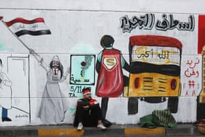 A mural painted by a young Iraqi woman depicting the tuk-tuk drivers who have been helping the protesters, acting as unofficial ambulances and mortuary vans. The text above vehicle reads: 'Tahrir Ambulance' (Tahrir means Liberation). Next to the bomb and flower is the word 'peaceful'.