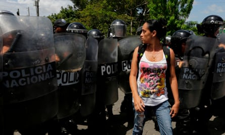 A woman confronts riot police blocking a street during a protest against Daniel Ortega's govenrment in Managua on 23 September 2018.