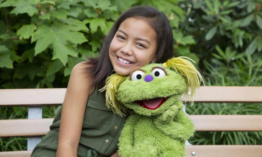 Ten-year-old Salia Woodbury, whose parents are in recovery, with the Sesame Street character Karli.