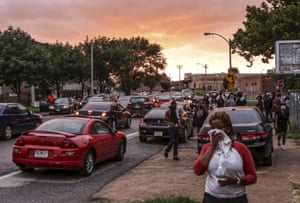 Residents cover their faces as the St. Louis Police Department used tear gas to disperse the growing crowd.