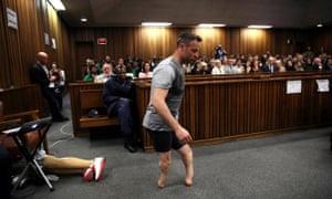 Oscar Pistorius walking across courtroom