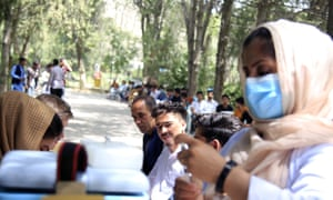 Afghan students wait to receives a dose of Covid-19 vaccine at Kabul University
