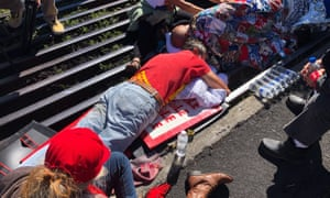 Activists lay chained to a cattle grate blocking a road at the base of Hawaii's tallest mountain on Monday.