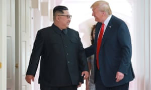 Donald Trump and Kim Jong-un walk to the summit at the Capella hotel on Sentsoa island in Singapore on 12 June.