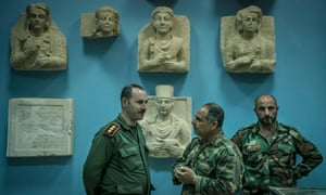 Syrian army officers seen near the frieze at the Palmira museum, Syria