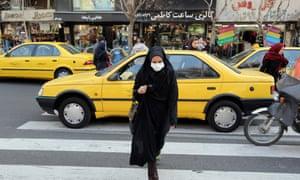 Pedestrian crossing a street in Tehran, Iran