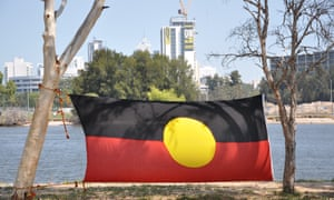 An Aboriginal flag at an Aboriginal tent embassy protest set up on an island in the Swan River in Perth