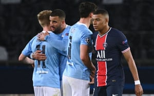 Paris Saint-Germain's Kylian Mbappe (right) looks dejected after the final whistle as Kyle Walker (econd left) and Manchester City's Oleksandr Zinchenko celebrate their victory.