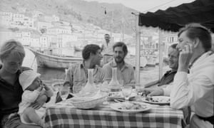 Marianne Ihlen, left, holds her son, Axel Jensen Jr, and Leonard Cohen, second left, with friends in Hydra, Greece, in October 1960.