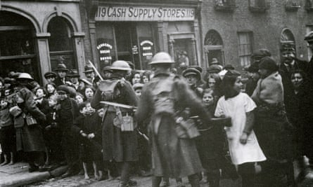 'A time of terror': British troops control crowds on the streets of Dublin in 1919.