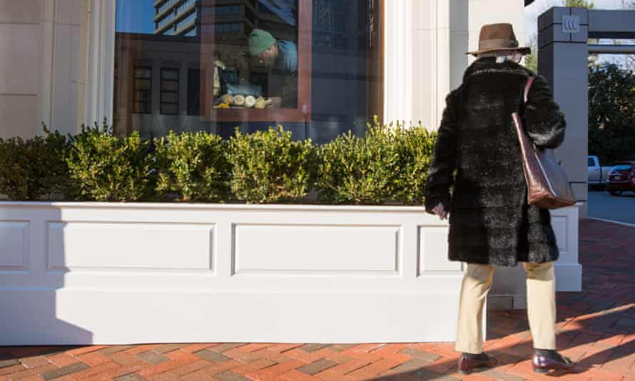 A woman dressed in fur walks by The Collection at Chevy Chase,