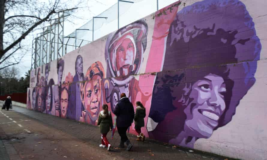 A feminist mural in Madrid featuring images of Frida Kahlo, Nina Simone and Rosa Parks.