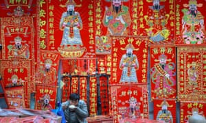 A vendor waits for customers at his market stall in Shenyang in China's north-eastern Liaoning province.
