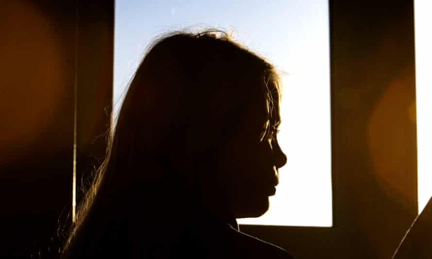 Silouette of girl's face by a window