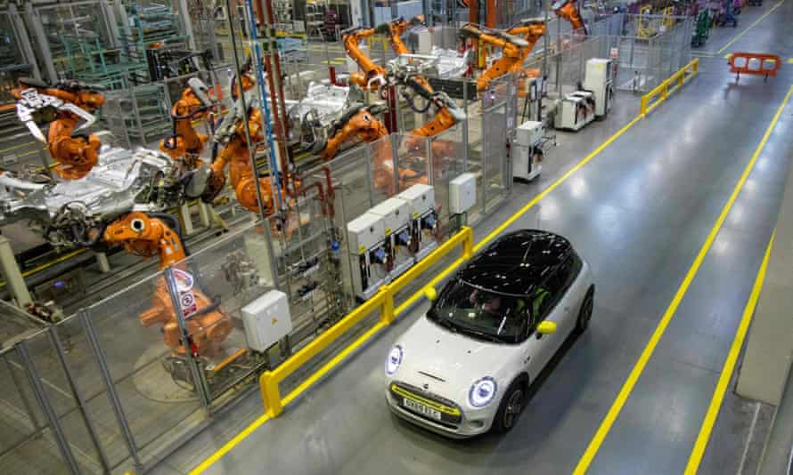 A Mini Electric car next to the production line at the BMW plant in Cowley, near Oxford.